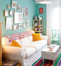 What to do if stuck with a whit sofa? Turquoise wall and colourful stripe rug.