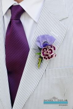The groom's seersucker suit perfectly framed his purple tie and boutonniere (Daniel Taylor Photography)