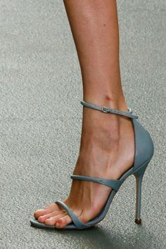 I like that her toe is creeping off the sole and that there is a tiny shaving cut on her ankle.  These details make the photo remind you that there is an actual woman attached to the shoe...Such shoes objectify women...dkl.