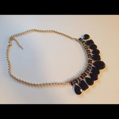 The Limited necklace Gorgeous large blacks tones with smaller purple and blue stones in a gold setting. Never worn although it no longer has the tag. The Limited Jewelry Necklaces