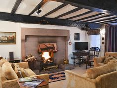 This beautiful, Grade II listed, 1672 coaching inn has a cosy open fire. Cosy Lounge, English Country Cottages, Open Fires, Ideal Home, Living Room, Coaching, Vacation, Home Decor, House