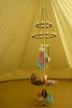 Bell tent pole with chandelier