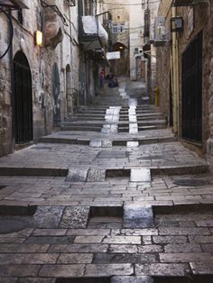ancient street in Old Jerusalem - notice how easily a wheeled cart can go up the steps