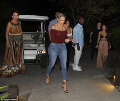 Solo:Khloe wore a maroon top and jeans. She still had on her tight braids and she had on strappy heels. Her beau Tristan Thompson was not seen