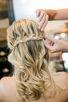 So flowing and so pretty is this half-up-half-down waterfall braided hairdo!  could hold the veil! by terri