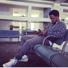 Currensy wearing the 'Hornets' Nike Air Force 1 High