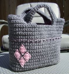 Crocheted bag, with felt and bead embellishments