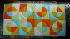 Drunkard's Path Decorative Quilt- Funky and fun, this colorful and aesthetically pleasing pattern puts a modern twist on the traditional pattern design.