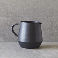 Pitcher with handle. Perfect for water or lemonade on a hot day. Black satin matte glaze over white stoneware. Measures 6.25 high, 7.25 wide (inclu...