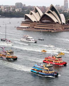 A flotilla of boats pass the Sydney Opera House during the annual ferry boat procession in celebration of Australia Day    //  Rob Griffith