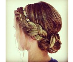 Dress up a traditional braided updo with a metallic headband and loose face-framing wisps of hair. A pop of gold elevates an everyday braid.