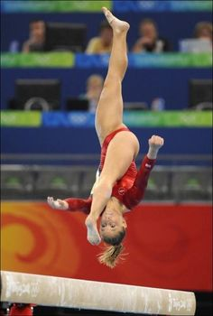 Focus. Gymnast. I bet she's lookin at where her foots going to land.