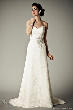 Alencon lace, featuring silk duchess bias ribbons and floral corsage at the natural waist.