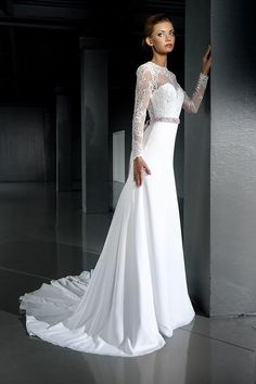 Very elegant lace wedding dress. Slimming silhouette with train.Gorgeous open back and sheer neck line with beautiful lace details. Simplicity