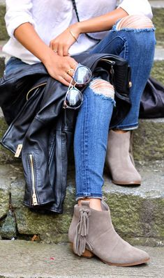 Ripped jeans and fringe boots