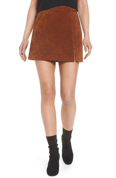 Transition your leg-flaunting looks into cooler weather with a miniskirt cut from ultrasoft suede and cleanly styled with sleek front welt pockets and a subtle side slit.