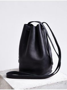 Black Leather Bucket Bag: Baggu Leather Drawstring Bucket Bag. Buy for $140 at Urban Outfitters.