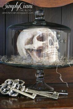 Halloween decor.. skull inside a cake stand