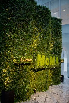 Topiary Logo // Similar to last year's event, organizers created a large topiary depicting the MoMA and Cartier logos to serve as the backdrop in the arrivals area. Wayfinding Signage, Environmental Graphics, Green Building, Topiary, Installation Art, Event Decor, Corporate Events, Event Design, Greenery