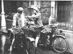 motolady: A pair of smokin' dames on their motorbikes in Britain, 1930s. Photographs of women motorcyclists from this time period always fascinate me; society norms changing quickly through the early 1900s allowed women to exercise and enjoy some new freedoms. Can you imagine wearing a corset on a motorcycle? Original photo source unknown, though I suspect it's from historial archives. [ more from the 1930s ]