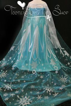 Elsa cape fabric Frozen silver glitter snowflake light blue shiny sheer organza fabric panel piece for making capes 90 long x 80 wide