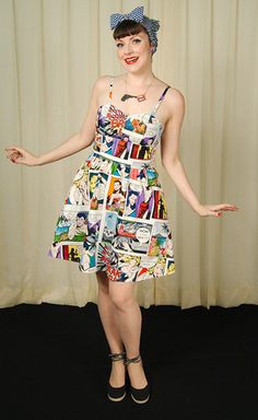This brightly colored cotton dress is perfect for those who love pop art and comic books! The white dress has an array of colors like