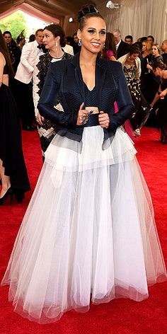 The Most Jaw-Dropping Dresses at the 2015 Met Gala | ALICIA KEYS | in a poufy white full skirt with structured navy jacket over a matching crop top and deep blue jewels.