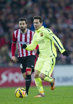 Lionel Messi of FC Barcelona duels for the ball with Mikel Balenziaga of Athletic Club during the La Liga match between Athletic Club and FC Barcelona at San Mames Stadium on February 8, 2015 in Bilbao, Spain.