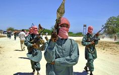 al shabaab fighters carries a rocket luncher on his shoulder