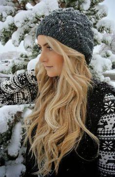 Snowy, blonde winter hair with a grey beanie.