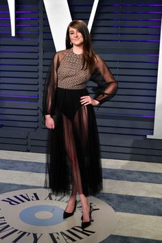 Shailene Woodley wore a Dior Pre-Fall 2019 black and gold embroidered tulle dress to the 2019 Vanity Fair Oscar Party. She accessorized with a Dior clutch + J'adior heels. Peplum Gown, Dior Dress, Sheer Dress, Tulle Dress, Shailene Woodley, Regina King, Kourtney Kardashian, Corsage, Soirée Des Oscars