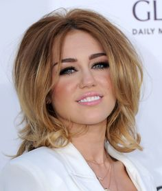 I have to admit, I like this haircut that Miley Cyrus is sporting. And the color.