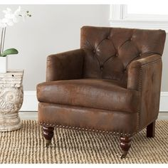 @Overstock.com - Safavieh Manchester Antiqued Brown Club Chair - This traditional brown club chair has an antique design that showcases classic style, fitting in with most home decor. This Manchester chair also has English caster feet and microfiber fabric, ensuring a comfortable place to sit and relax.  http://www.overstock.com/Home-Garden/Safavieh-Manchester-Antiqued-Brown-Club-Chair/5691000/product.html?CID=214117 $349.99