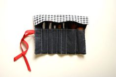DIY makeup brush holder - I need a small kit for traveling, I could build my own.