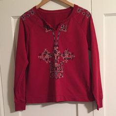 """Lucky Brand Red Aztec Embroidered Boho Sweatshirt Lucky Brand red """"Aztec Embroidered Sweater"""". Is actually more of a sweatshirt. Gorgeous rich red color. Features beautiful and trendy multicolor bohemian embroidery at front. Ribbed, crew neck with cut-in v-neck. Long sleeves with ribbed cuffs. Thin and flattering fit. Please note, all tags have been cut off. Would best fit a medium. Please inquire for specify measurements if interested. Feels like cotton. Excellent condition with no noted…"""