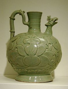 A late 10th century grey sandstone and celadon-glazed pitcher from the Song Dynasty (960–1279); the spout is in the form of a fenghuang head.