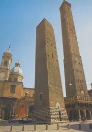 The famous Due Torri, the Asinelli and the Garisenda. The first and highest, is 97.20 meters and an inclination in the top of 1.6 m, and can be visited. The second one with 48 meters a tilt of 3.22 m at the top, and  is not visitable.  Bologne - Italy