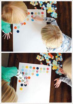 Circle punch kids art project using scrap paper. Beautiful, easy geometric kids wall art!