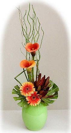 Floral arrangement with two favorites.Gerbera Daisies and Calla Lilies Ikebana Arrangements, Tropical Floral Arrangements, Ikebana Flower Arrangement, Beautiful Flower Arrangements, Beautiful Flowers, Contemporary Flower Arrangements, Artificial Floral Arrangements, Home Flowers, Church Flowers
