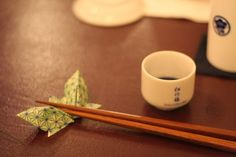 In Japan, you must never pass food between pairs of chopsticks. It's considered bad luck as it evokes funeral rites.