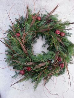 Custom Christmas Wreath - Pheasant Feathers, Pomegranate, mixed Cedar, and Corkscrew Willow. Decorations Christmas, Homemade Christmas Wreaths, Christmas Door Wreaths, Christmas Swags, Christmas Makes, Holiday Wreaths, Christmas Crafts, Handmade Wreaths Christmas, Winter Wreaths