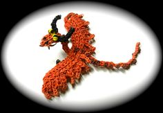 How to Loom Your Dragon (Single Loom Timberjack Baby) tutorial by Cortney Nicole. Advanced Level Project.
