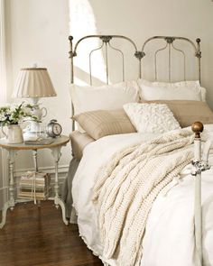 "White can be the most warming color of them all, swears interior designer (and renowned colorist) Jamie Drake. ""Benjamin Moore's Mayonnaise is the perfect neutral,"" he states. Other whites can look crisp and cold, but this hue's creamy yellow base makes it truly versatile. For layered complexity, like what's shown in this bedroom, weave together several tones—from the walls and furniture to the lampshades, pillows, and accessories."