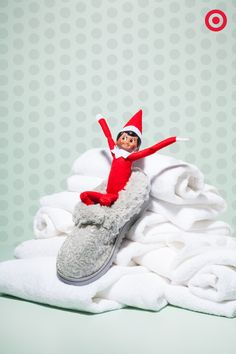 A slipper sled? A boot toboggan? Elf On The Shelf is trying them all out after building a sledding hill out of all the towels in the linen closet.