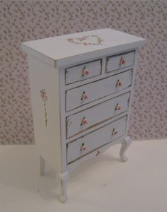 Shabby Chic  tall  Chest of drawers, ,  distressed white with rose bouquets,  Twelfth scale dollhouse miniature. $16.00, via Etsy.