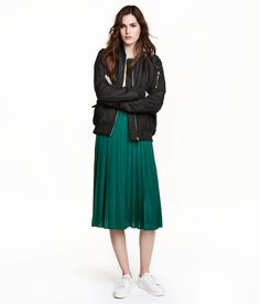 A deep green midi skirt for an unexpected pop of color.