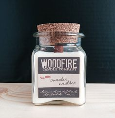 Wood wick apothecary cork topped jar soy candles hand poured in Duluth, MN. Perfect for gift giving or keeping for yourself. Comes with a hand stamped cotton bag! Perfect packaging.