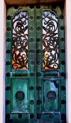 Love this door - the iron, the color, the glass