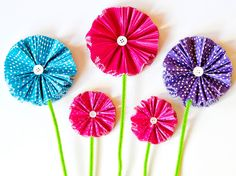 DIY Network has easy step-by-step instructions for colorful paper flowers, fun for kids and moms!