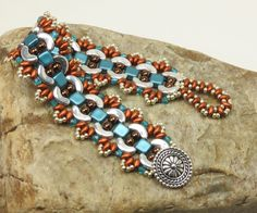 ARCOS-SUPERDUO-TILE Bracelet-Pastel Emerald-Crystal Bronze Fire Red-Silver-Dark Bronze-Bali Button-Arcos Bracelet(ARC2) by CinfulBeadCreations on Etsy